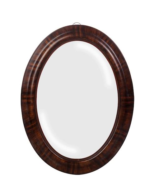 흰색 표면에 고립 된 갈색 테두리가있는 둥근 거울의 근접 촬영 무료 사진