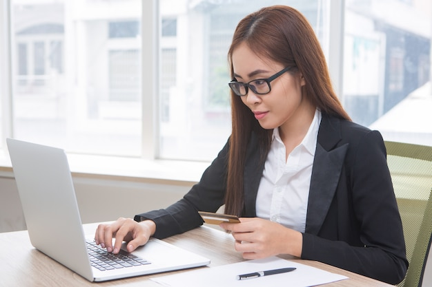 Closeup of Business Woman Doing Online Banking Free Photo