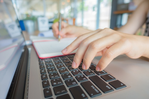 Closeup of business woman hand typing on laptop keyboard . Free Photo