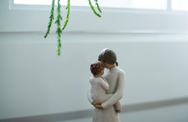 Closeup of motherhood figure Free Photo