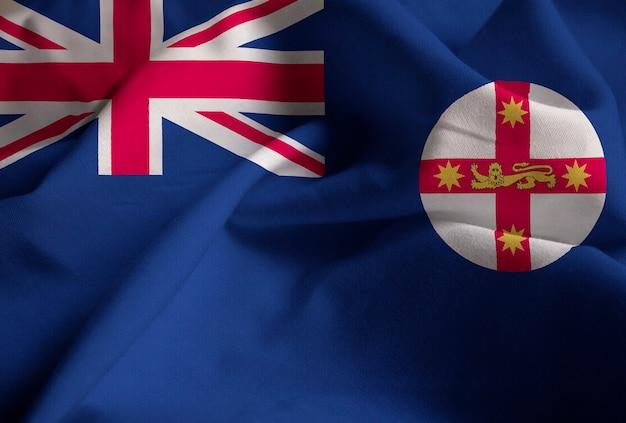 Макрофотография фальшивый новый южный уэльс, новый южный уэльс флаг, дующий в ветре Premium Фотографии