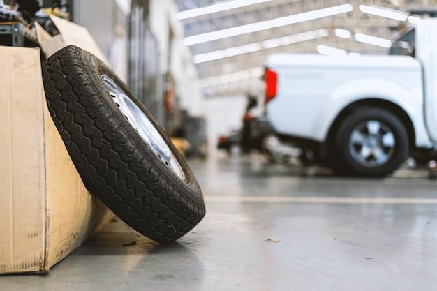 Closeup old tire in car repair station Premium Photo
