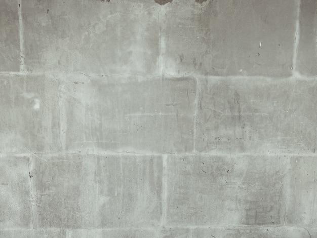 灰色の石屋外レンガ壁テクスチャ背景へのクローズアップ Premium写真