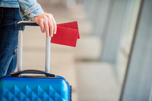 Closeup passports and boarding pass at airport indoor background airplane Premium Photo