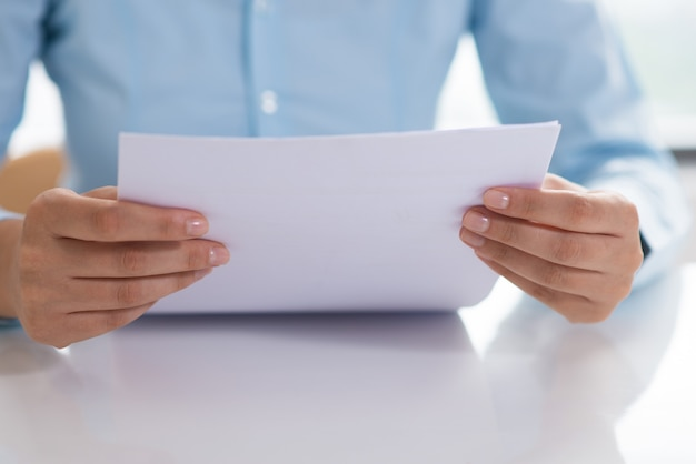 Closeup of person reading document Free Photo