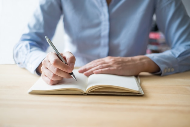 [Image: closeup-person-writing-notebook-table_1262-8274.jpg]