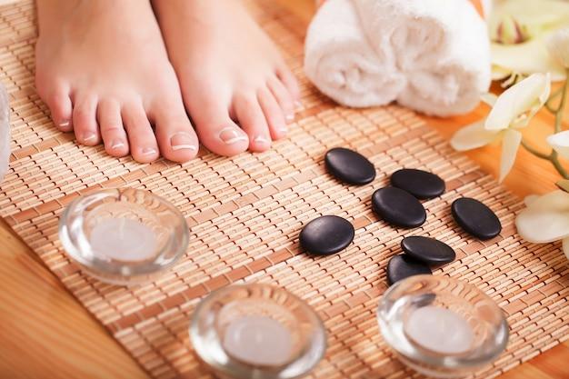 Closeup photo of a female feet at spa salon Premium Photo