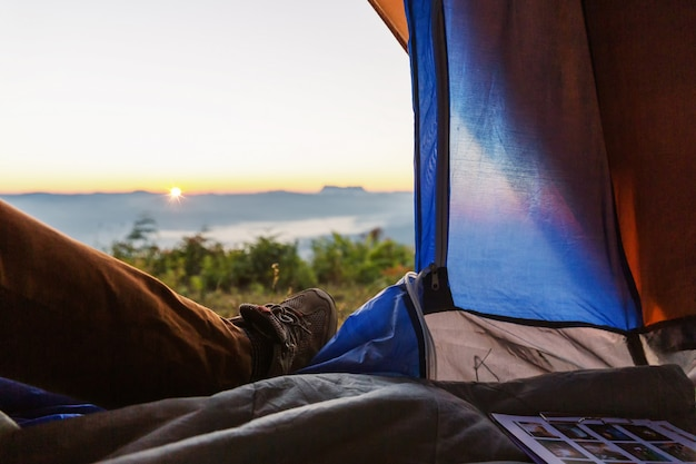 Closeup photo of legs in tent. travel trekking expedition concept Free Photo