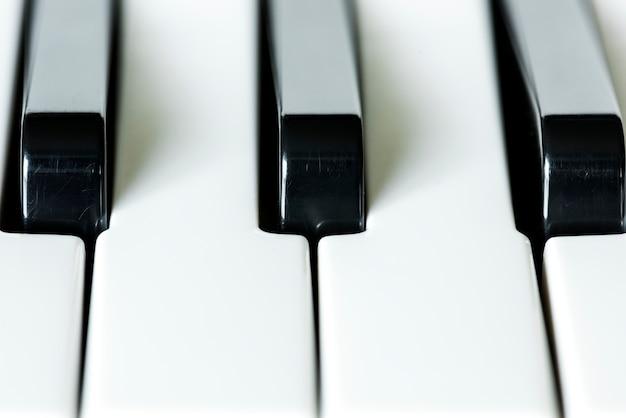 Closeup of piano keyboard Free Photo