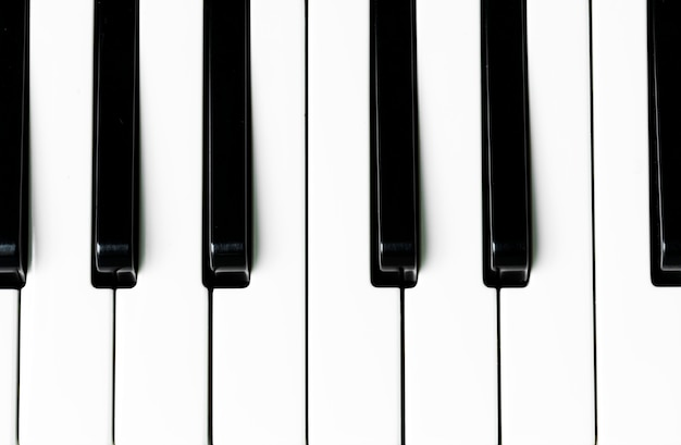 Closeup of piano keyboard Free Photo