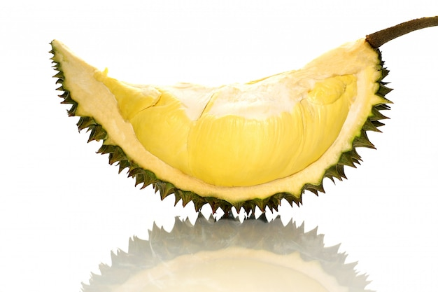 Closeup piece ripe durian monthong in thailand, isolate on white background with shadow reflect. Premium Photo