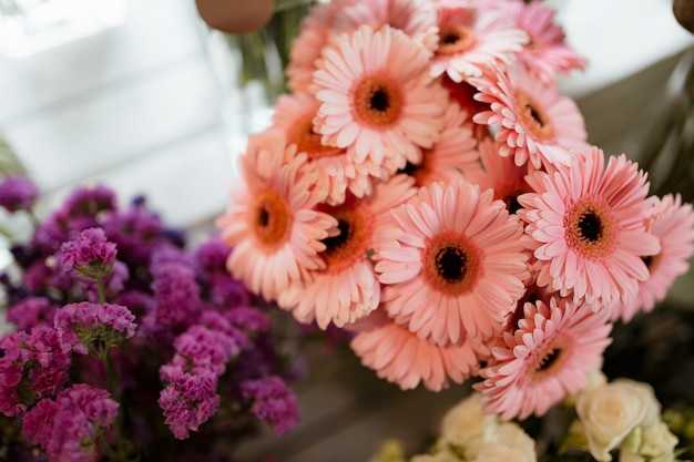 Closeup of pink gerber daisy bouquet and purple statice Free Photo