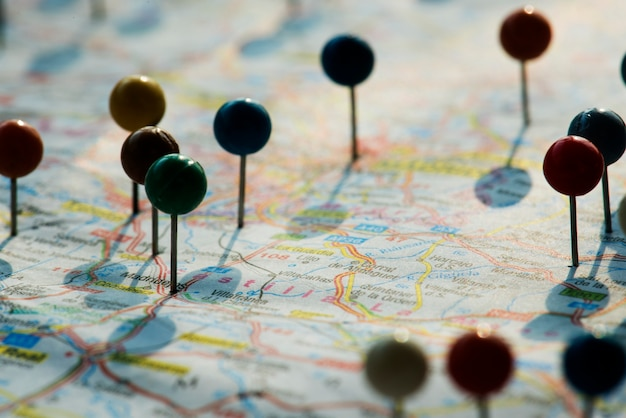 Closeup of pins on the map planning travel journey Free Photo