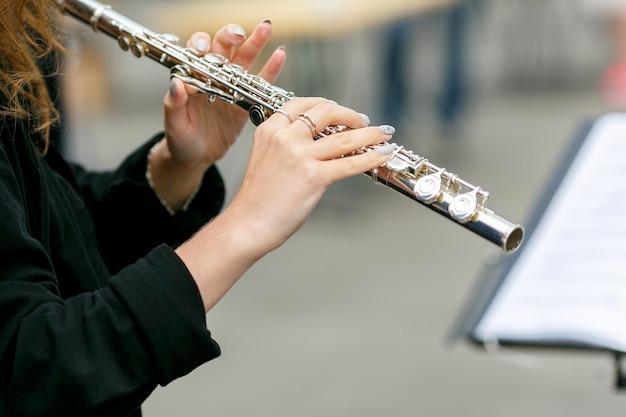 A closeup plane of street orchestra flute player Premium Photo