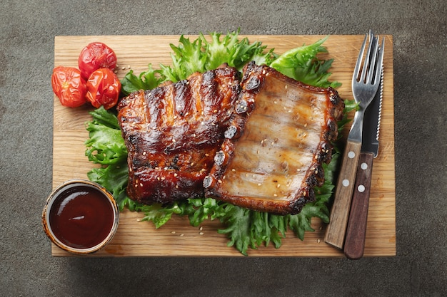 Closeup of pork ribs grilled with bbq sauce. Premium Photo