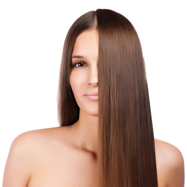 Closeup portrait of a beautiful young woman with elegant long shiny hair Premium Photo