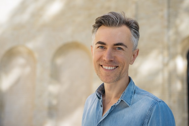 Closeup portrait of handsome middle aged man with stylish hairstyle wearing casual shirt Premium Photo