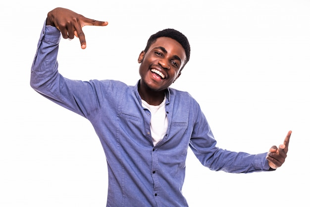 Closeup portrait happy, excited, successful young man giving peace, victory or two sign, isolated white wall. positive emotions, face expressions, feelings, attitude, reaction, perception Free Photo