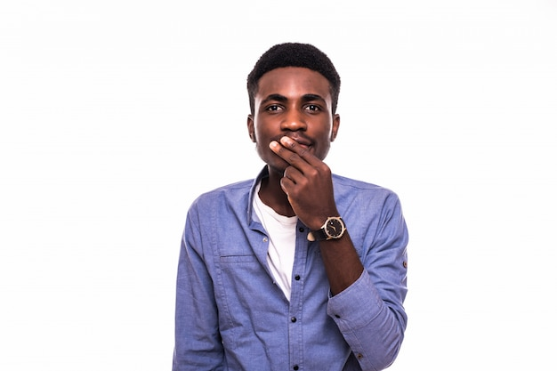 Closeup portrait petrified young handsome man looking shocked surprised in disbelief, hands covering mouth, big eyes, isolated white wall. positive human emotion facial expression feeling Free Photo