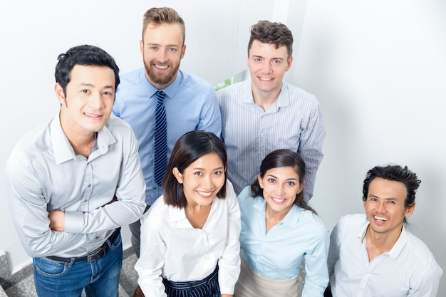 Closeup portrait of smiling business team on stairway Free Photo