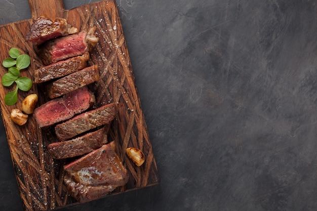 Closeup ready to eat steak new york. Premium Photo