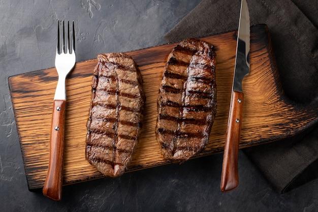 Closeup ready to eat steak top blade. Premium Photo