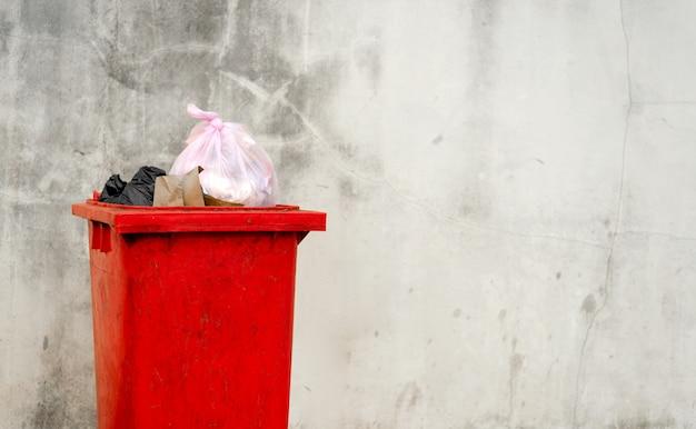Closeup red trash bin Premium Photo