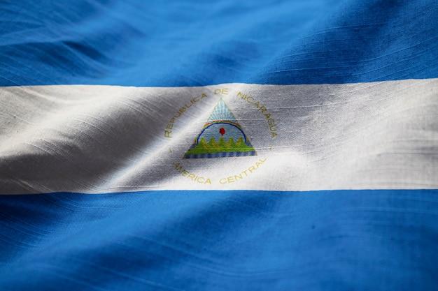 Closeup of ruffled nicaragua flag, nicaragua flag blowing in wind Premium Photo