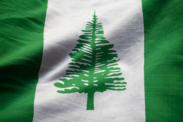 Closeup of ruffled norfolk island flag, norfolk island flag blowing in wind Premium Photo