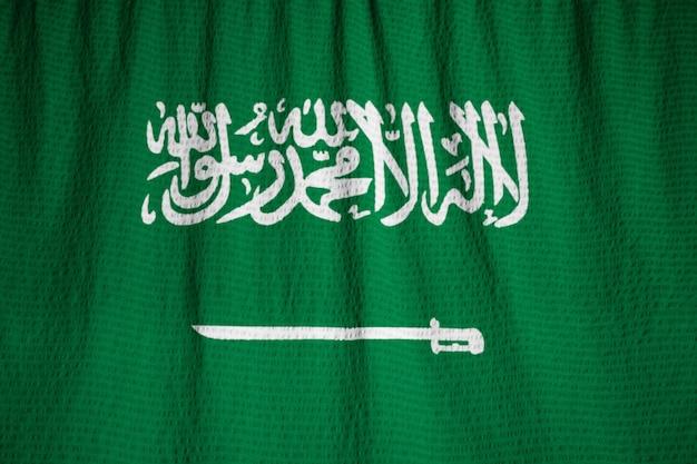 Closeup of ruffled saudi arabia flag, saudi arabia flag blowing in wind Premium Photo