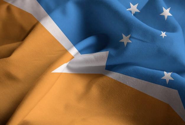 Closeup of ruffled terra del fuego flag, terra del fuego flag blowing in wind Premium Photo