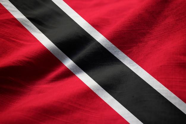 Closeup of ruffled trinidad and tobago flag, trinidad and tobago flag blowing in wind Premium Photo