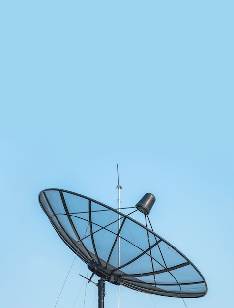 Closeup satellite dish on beautiful clear blue sky textured background with copy space Premium Photo
