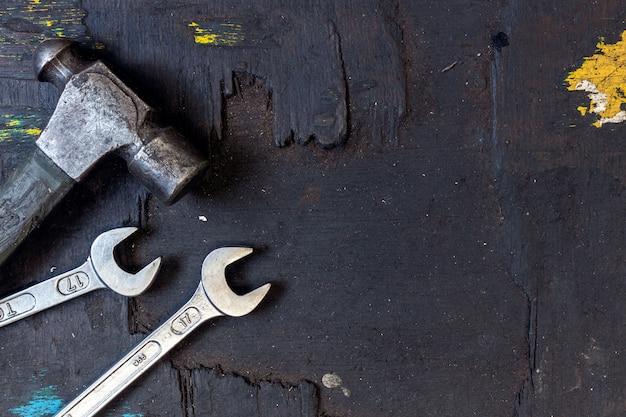 Closeup set of tools for motorbike repair background Premium Photo