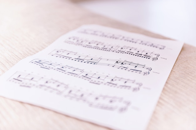 Closeup sheet with musical notes lying on the bed Premium Photo