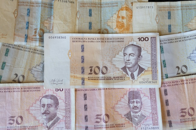 Closeup shot of the banknotes of bosnia and herzegovina currency spread on the surface Free Photo