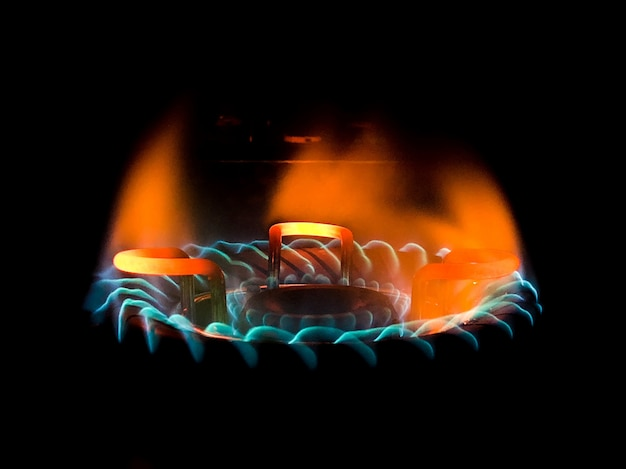 Closeup shot of a beautiful blue-green flame in a gas stove Free Photo