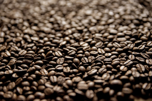 Closeup shot of coffee beans with a blurred background great for background Free Photo