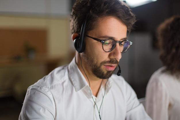 Closeup shot of confident call center operator Free Photo