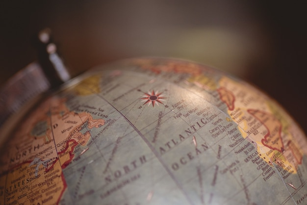Closeup shot of a desk globe with a blurred background Free Photo