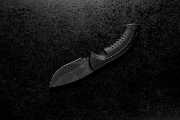 Closeup shot of an edc pocket knife with a black holder Free Photo