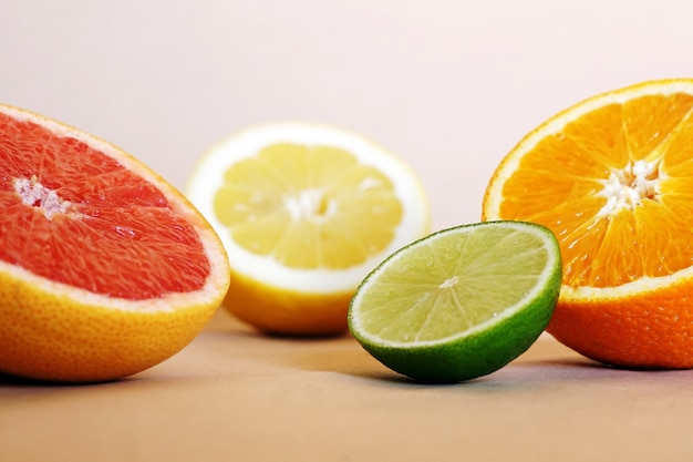 Closeup shot of fresh oranges, limes and grapefruits on the table Free Photo