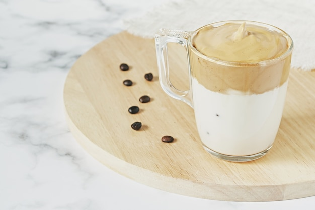 Closeup shot of iced dalgona whipped coffee with fluffy creamy Free Photo