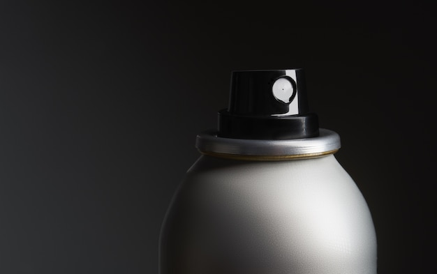 Closeup shot of a metal bottle with spray Free Photo