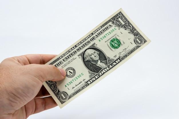 ドル札を持っている人のクローズアップショット 無料写真