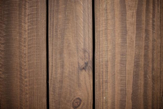 垂直の木製の板で作られた壁のクローズアップショット-クールな壁紙の背景に最適 無料写真