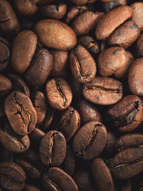 新鮮なコーヒー豆のクローズアップショット-コーヒーの質感 無料写真