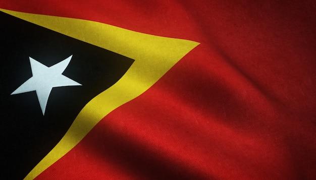 興味深いテクスチャと現実的な東ティモールの旗のクローズアップショット 無料写真