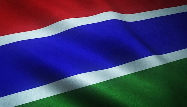 興味深いテクスチャとガンビアの旗を振っているのクローズアップショット 無料写真