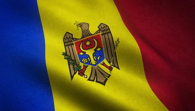 興味深いテクスチャとモルドバの旗を振っているのクローズアップショット 無料写真